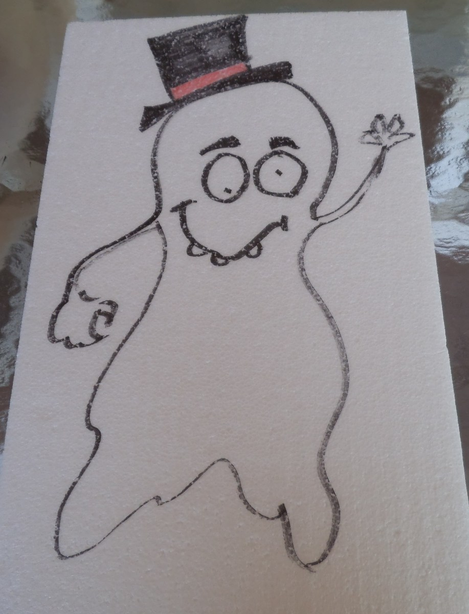 The toothy grin adds some fun to the picture. This ghost has skinny arms and almost has legs. How do you like his hat?