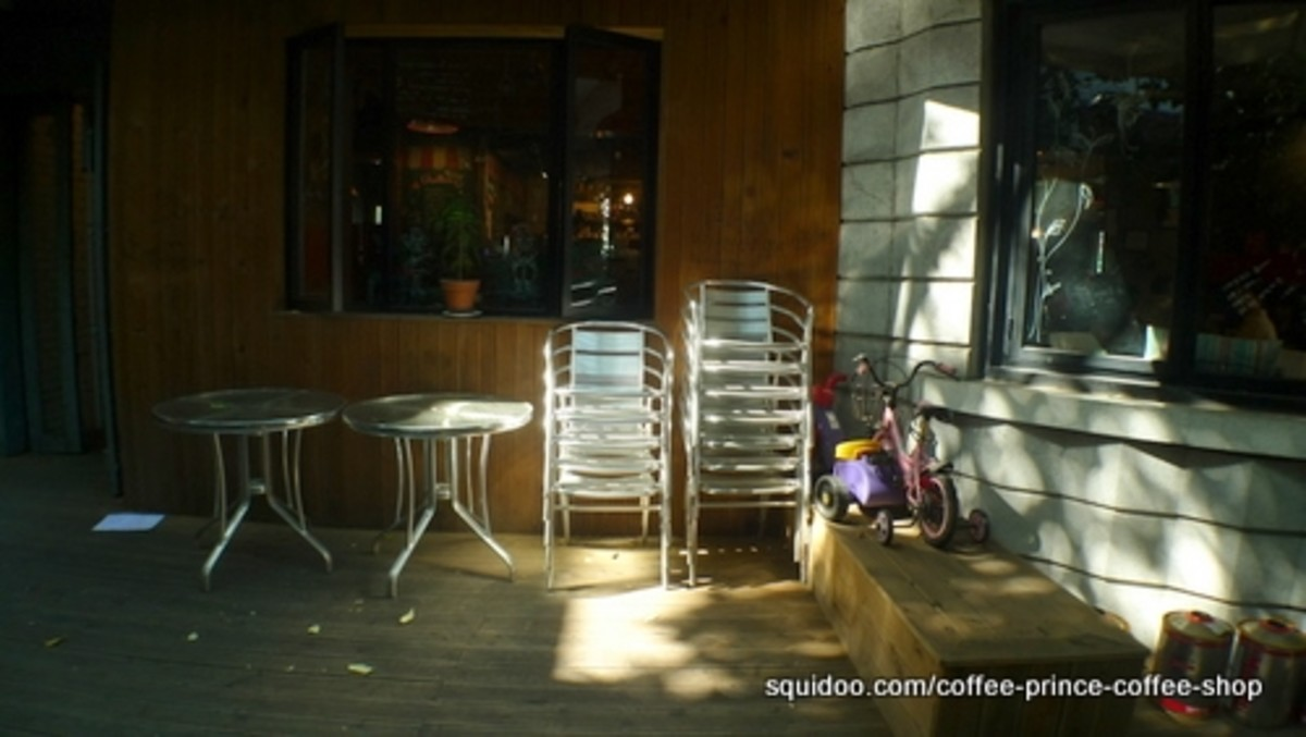 Spare chairs and tables outside the coffee shop.