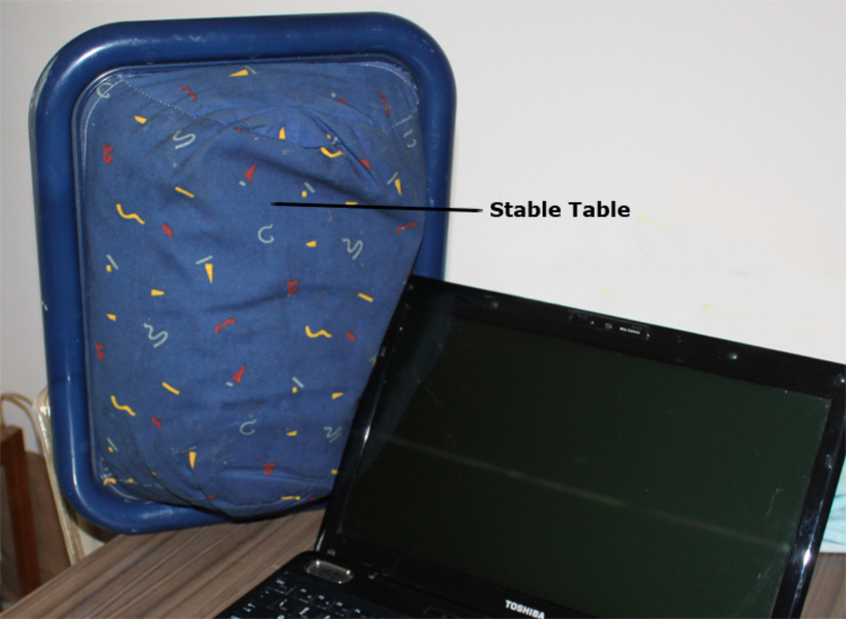 It would be better to use a Stable Table under your LapTop computer than a cushion!