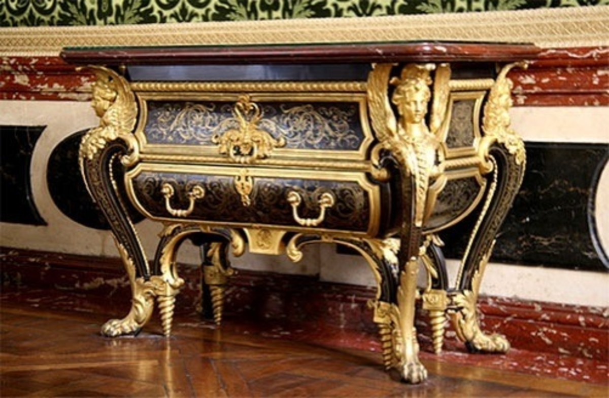 A Louis XIV cammode inlaid with Boullework which was a form of marquetry named after the French cabinet maker Andre-Charles Boulle (1642-1732) who liked to combine materials such as tortoise shell, ivory, and ebony with brass.