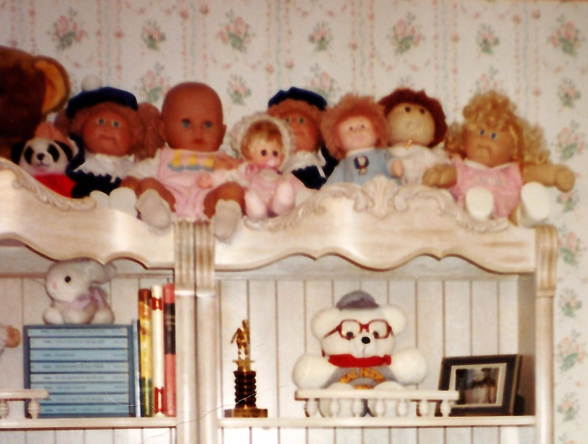 Some of my niece's collection of Cabbage Patch Kids atop some bookshelves in her bedroom back in the 1980s.