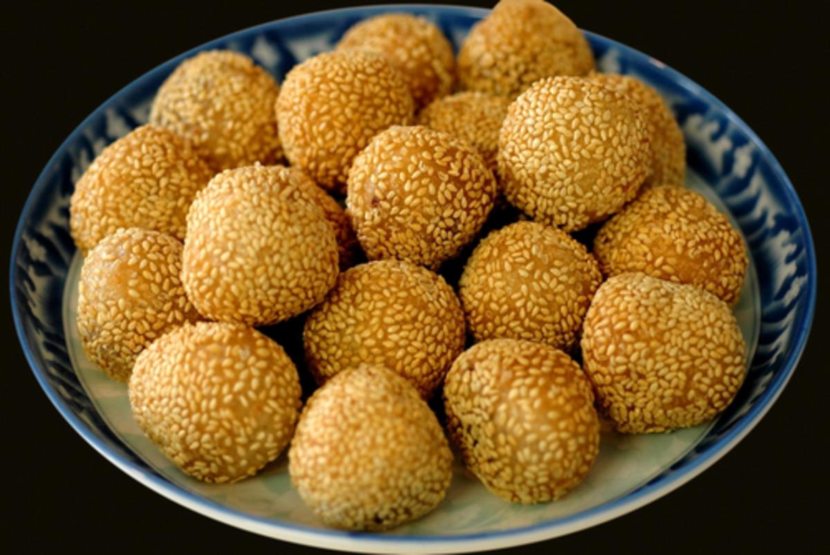 Sesame coated deep fried Glutinous Rice Balls, a popular Chinese dessert/snack. Image:  Yan Guo Shutterstock.com