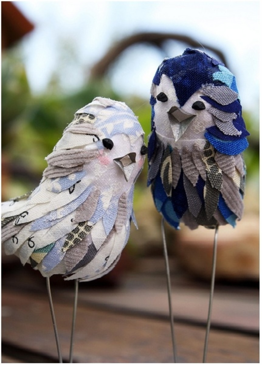 These are actually cake toppers, but they would be just as cute as decorations for a table, windowsill or mantelpiece. You just need to shape the bodies out of clay, paper mache, foam or other material, and then decorate them.