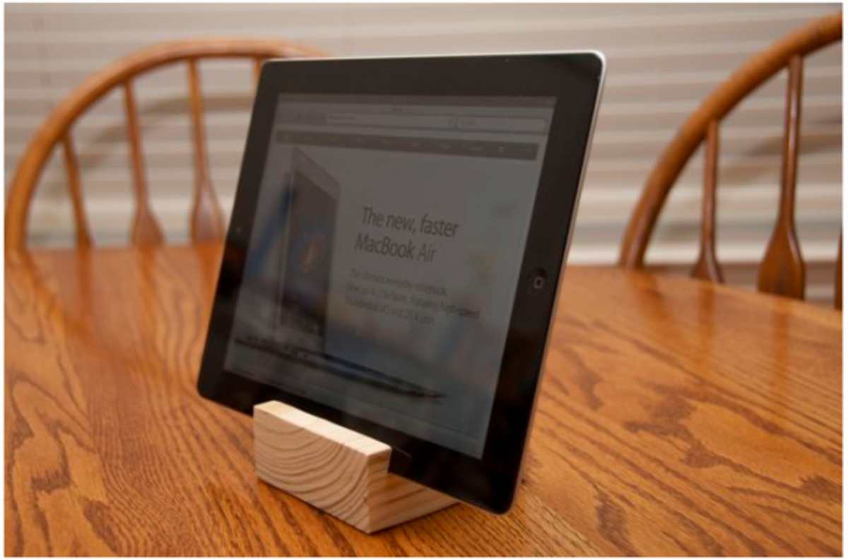 Easy homemade gift for a gadget fan by simply making a slot in a block of wood.