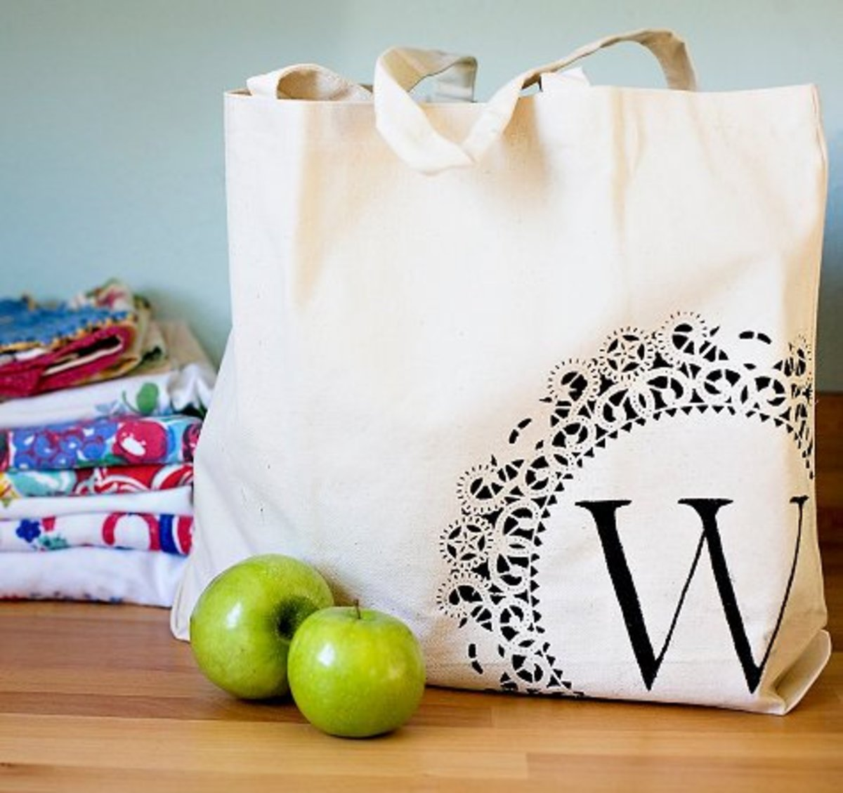 Buying a cheap plain tote bag and personalizing it with fabric paint is a great idea for a gift!