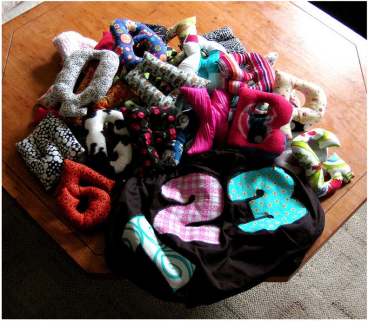 A complete set of sewn softie letters with a handmade drawstring bag. This would make a wonderful baby shower gift!