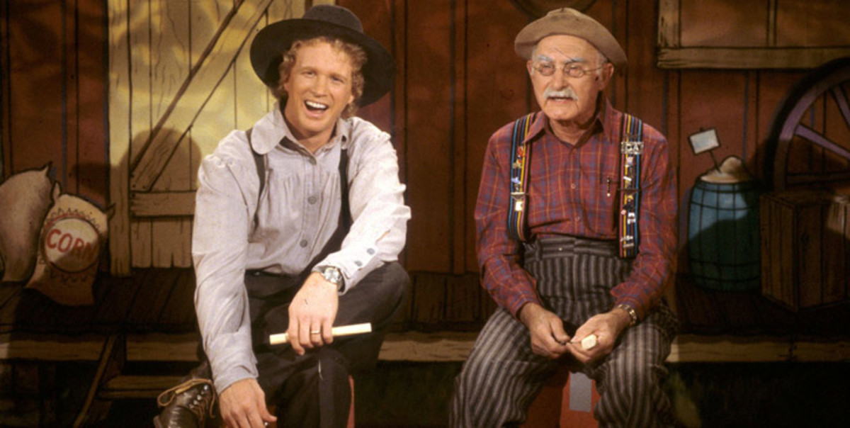 Mike Snider with Grandpa Jones, who would introduce the finger-picker to the clawhammer style of playing banjo, on the set of Hee Haw.