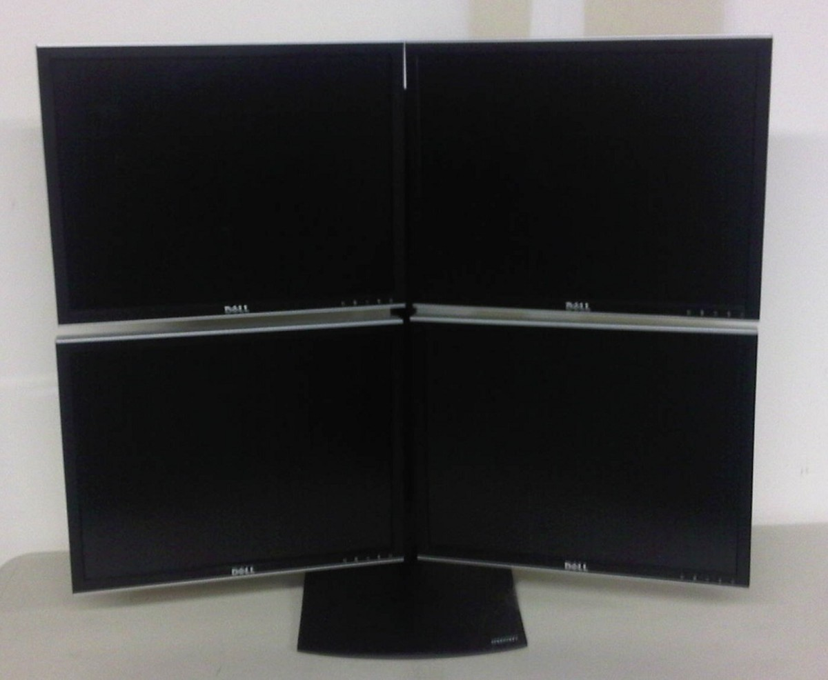 """Ergotron DS100 Quad Stand with four 20"""" Dell LCD Monitors"""