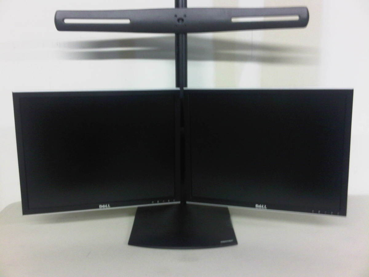 Mount the bottom two monitors first so the stand doesn't become top heavy