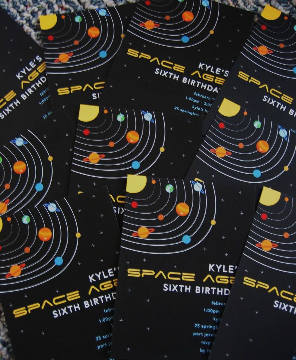Set the interstellar stage with custom, solar-system-themed invitations!