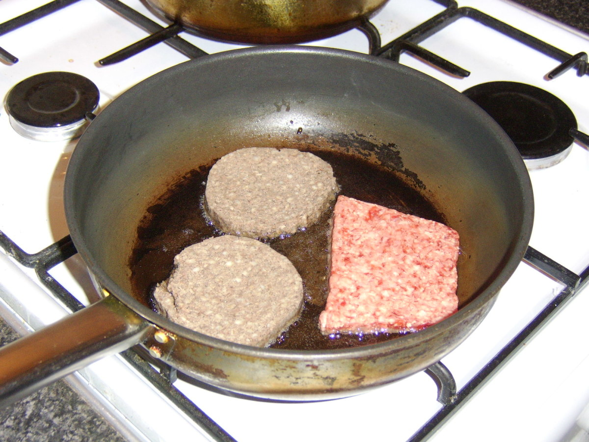 Haggis slices and Lorne sausage are shallow fried in vegetable oil