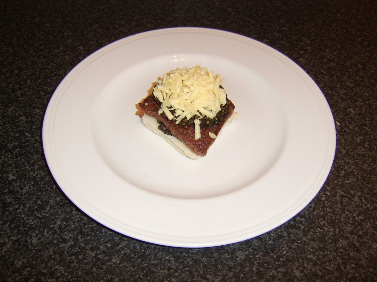 Scottish cheddar is grated and placed on top of the haggis and Lorne sausage