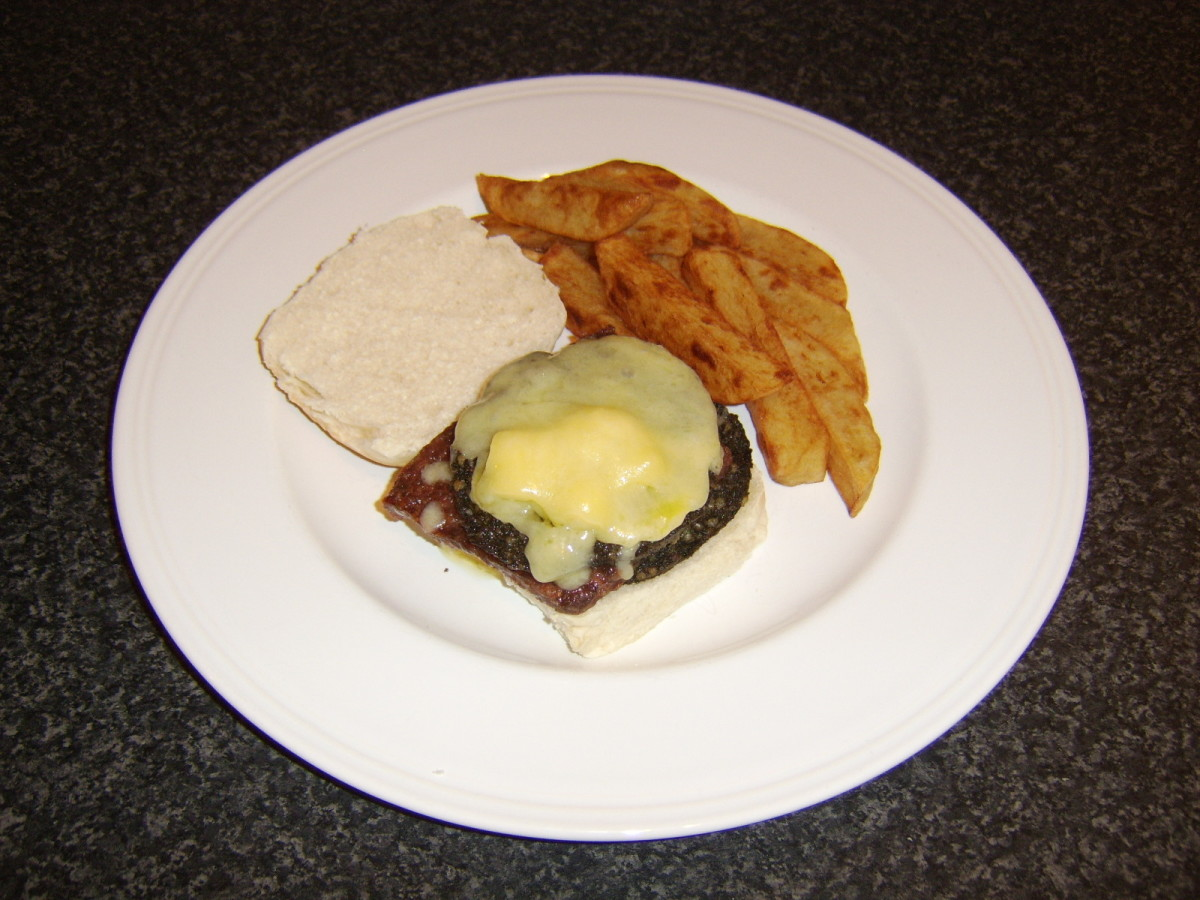 Cheese is melted over the haggis and Lorne sausage on a Scottish morning roll
