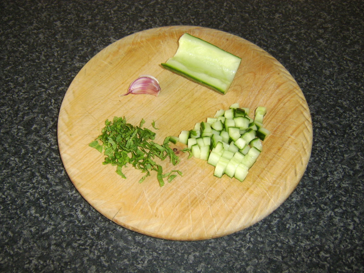 Preparing the cucumber, mint and garlic for the raita