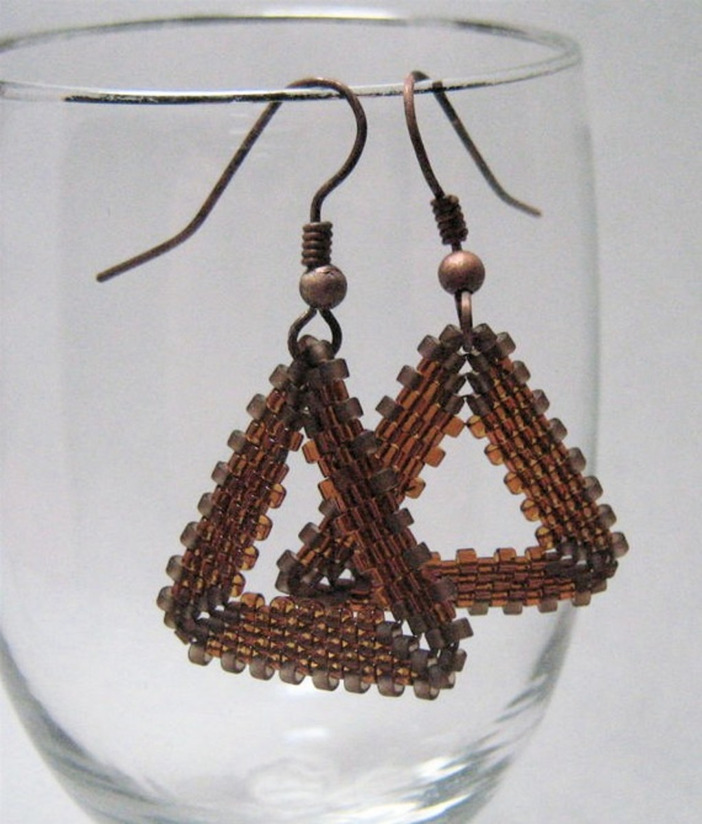 You can attach your earring or pendant loops at the triangle points or in the middle of the triangle sides.  Also consider different types of wire for your earrings and different stringing options for pendants and necklaces.