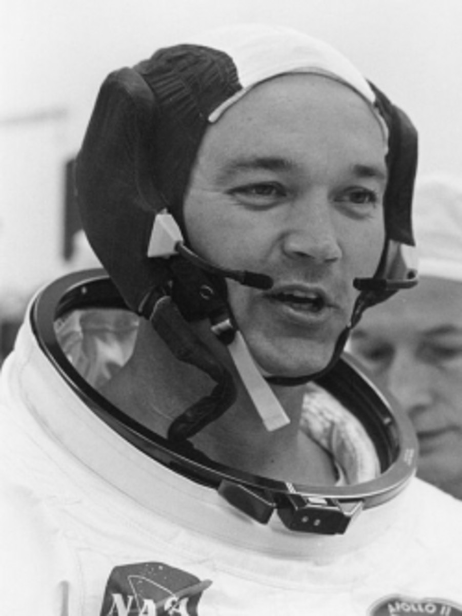 """Michael Collins suiting up Apollo 11"" by not named, NASA - nasa.gov. Licensed under Public domain via Wikimedia Commons - http://commons.wikimedia.org/wiki/File:Michael_Collins_suiting_up_Apollo_11.jpg#mediaviewer/File:Michael_Collins_suiting_up_Apo"
