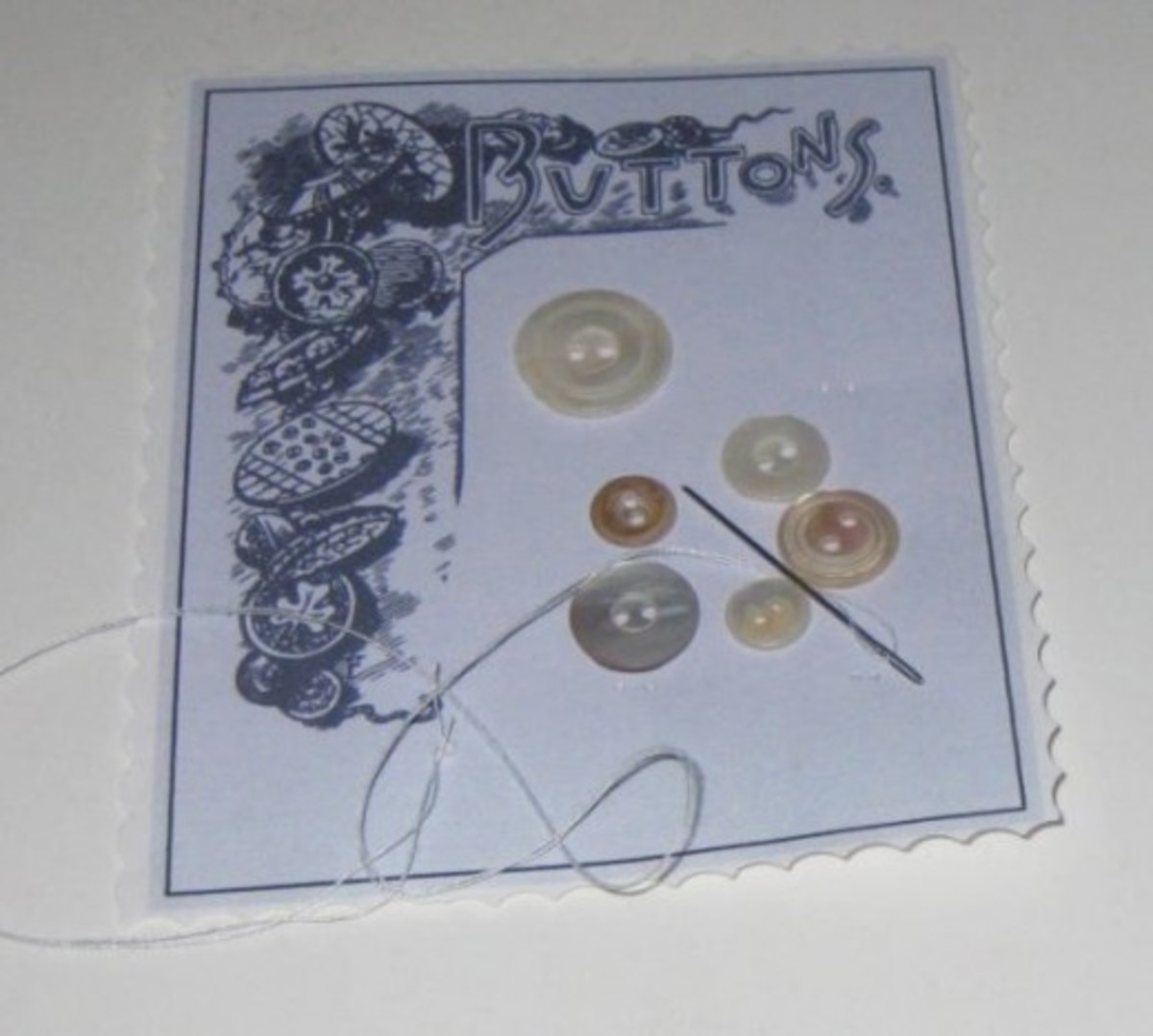 Use needle and thread to sew buttons on the card. Secure the thread on the back when all the buttons are sewn on.