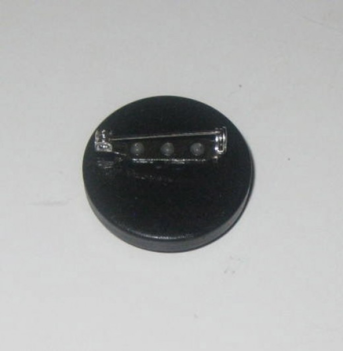 Back of button brooch.