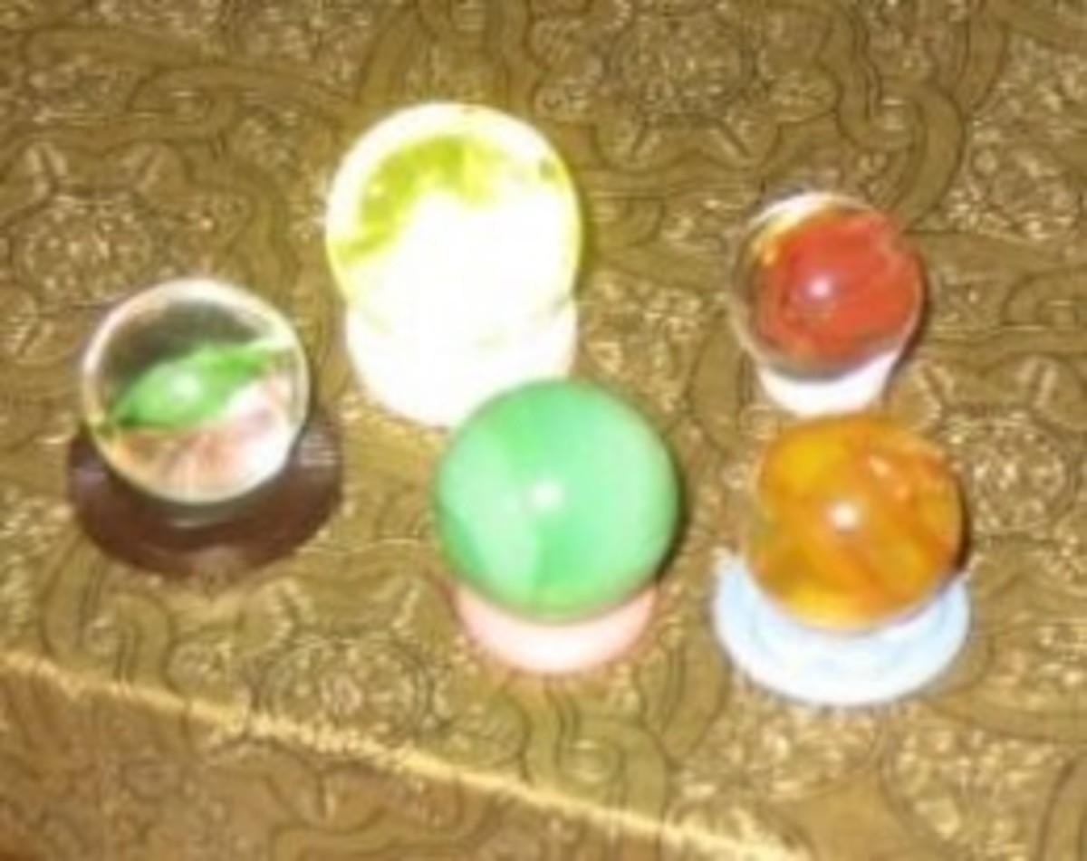 Vintage buttons hold vintage marbles.