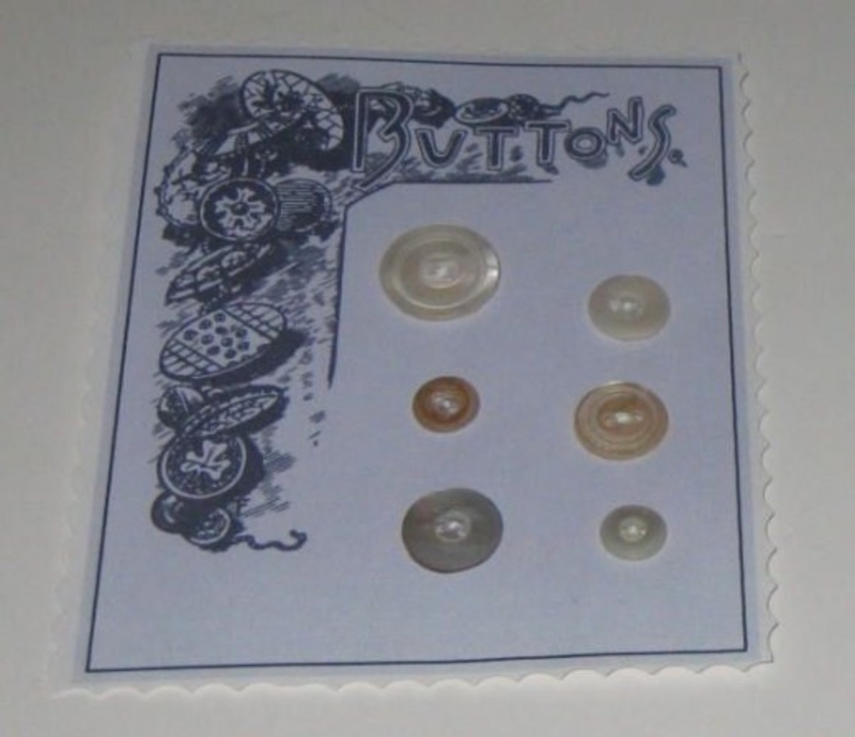 Display buttons on a decorative card.