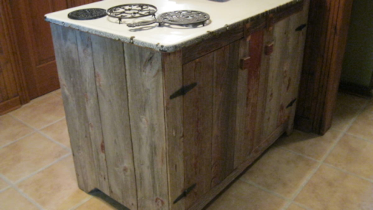 Custom built from re-claimed barnwood, this kitchen island is right at home on top of the ceramic tile floor of the kitchen.