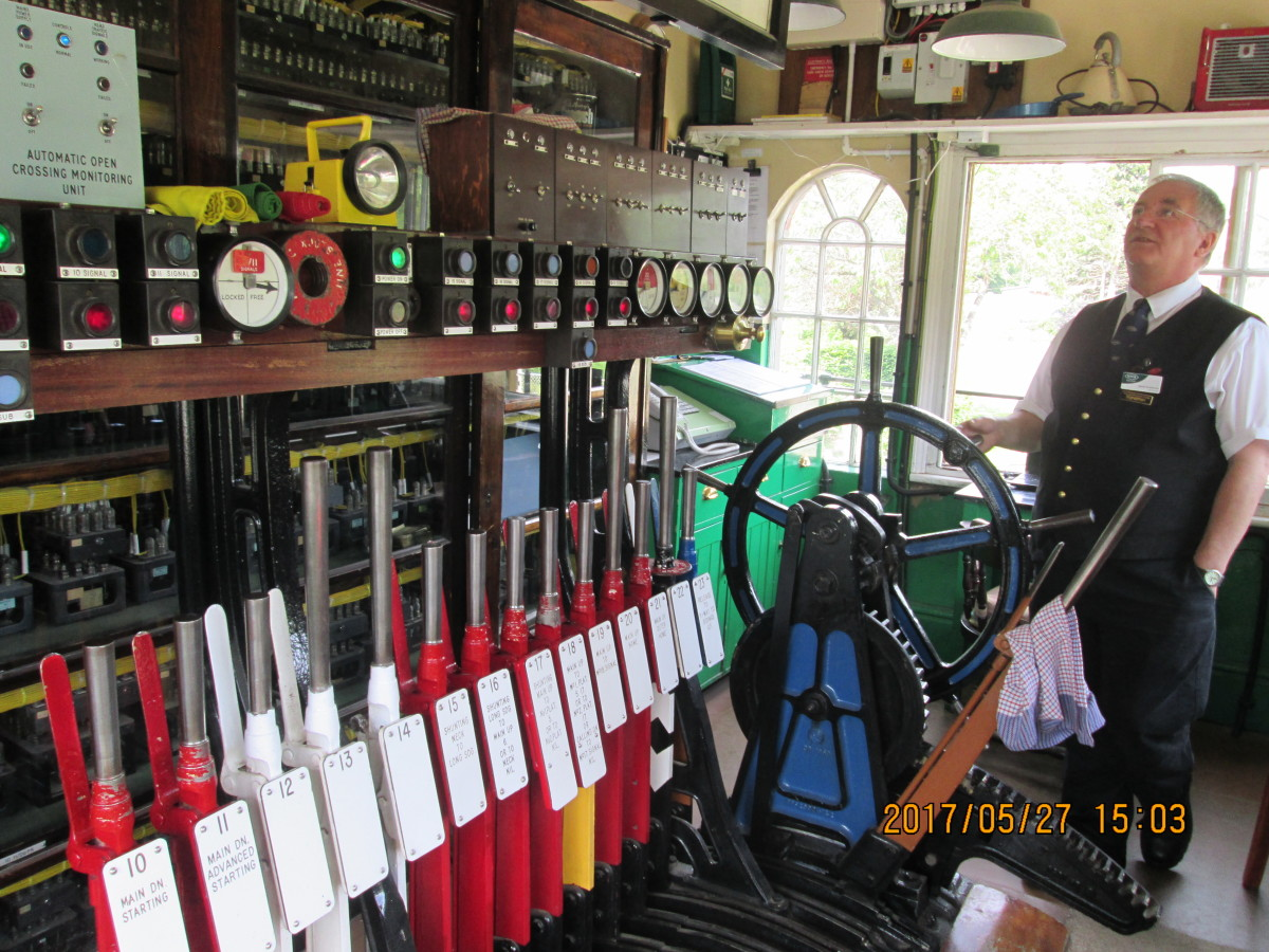 In the cabin operating floor are instruments his Grandad would recognise, with bells and blocks on the shelf, spare levers (white) and a gate lever. Levers not in use were 'collared' - see near gate wheel, right. There are signs of new technology