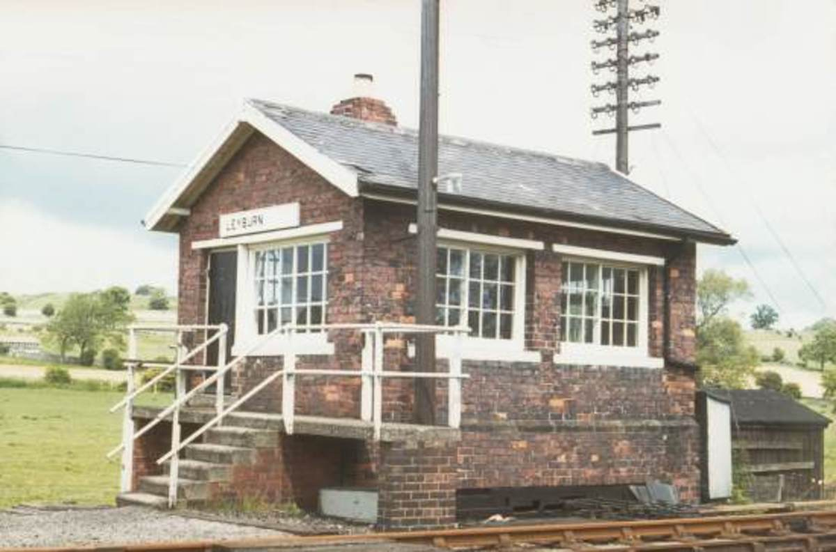 Leyburn Signal Cabin (demolished) on the Wensleydale Railway was a regular NER Southern Divison cabin with a token exchange platform added on to the access steps