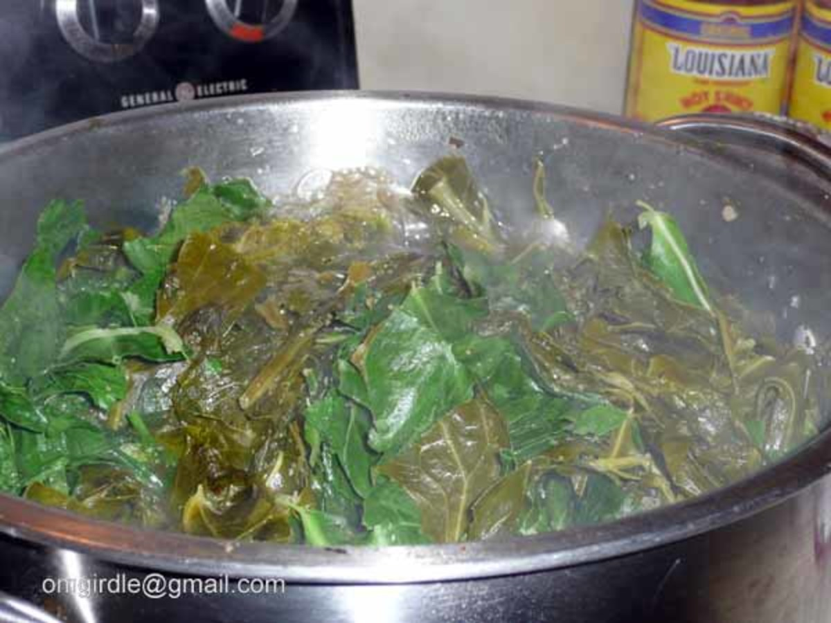 BRING PARTIALLY COOKED GREENS UP FROM THE BOTTOM WHILE ADDING MORE GREENS TO POT.