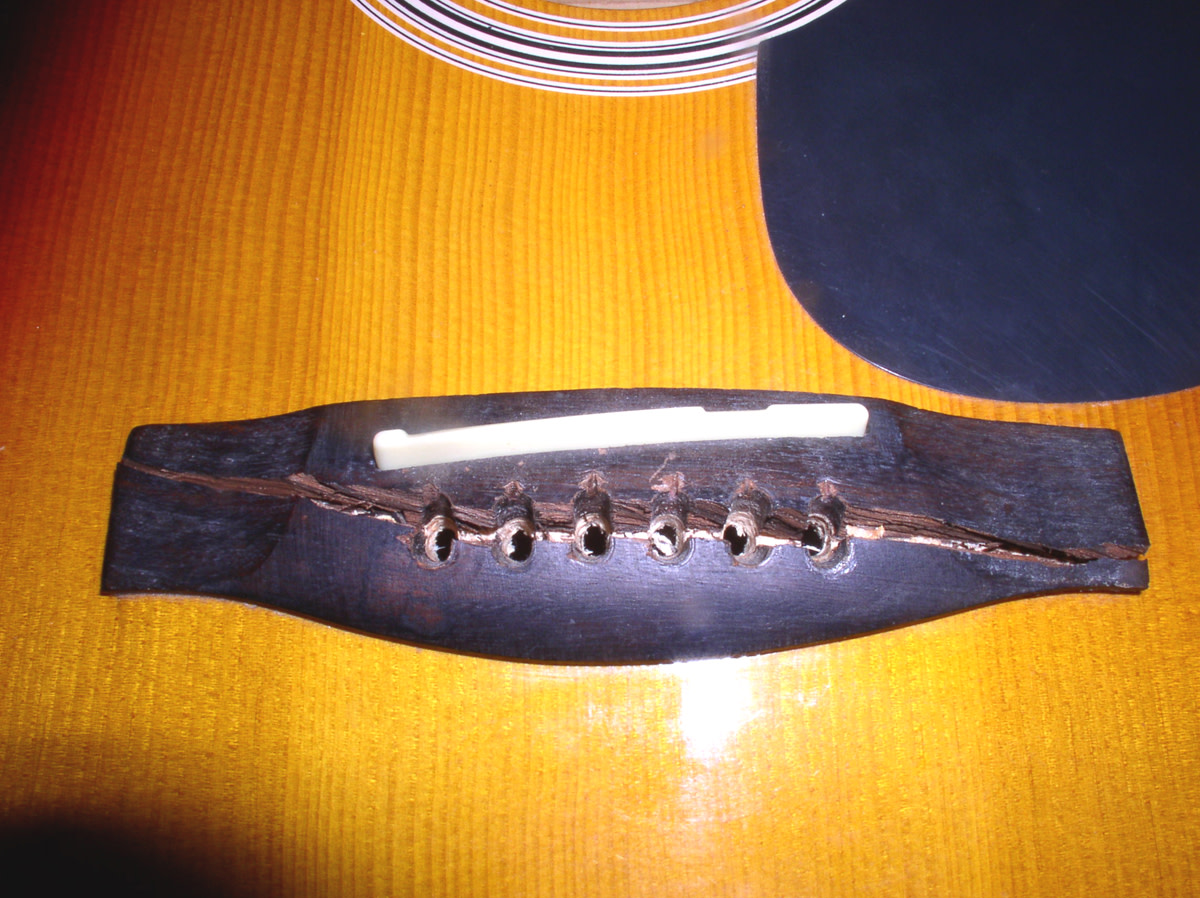 How to fix a split bridge on an acoustic guitar