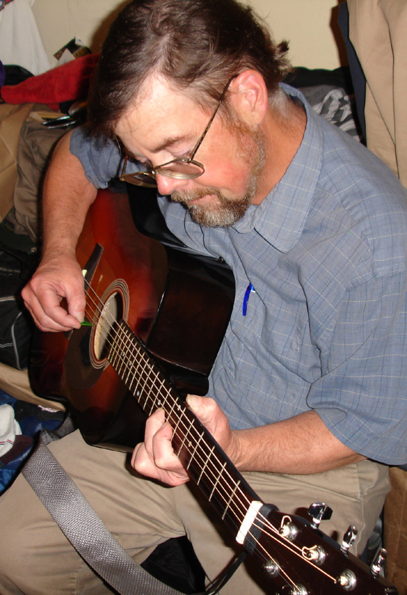 Playing repaired guitar. ( It's a keeper) All I need now is a good guitar teacher.