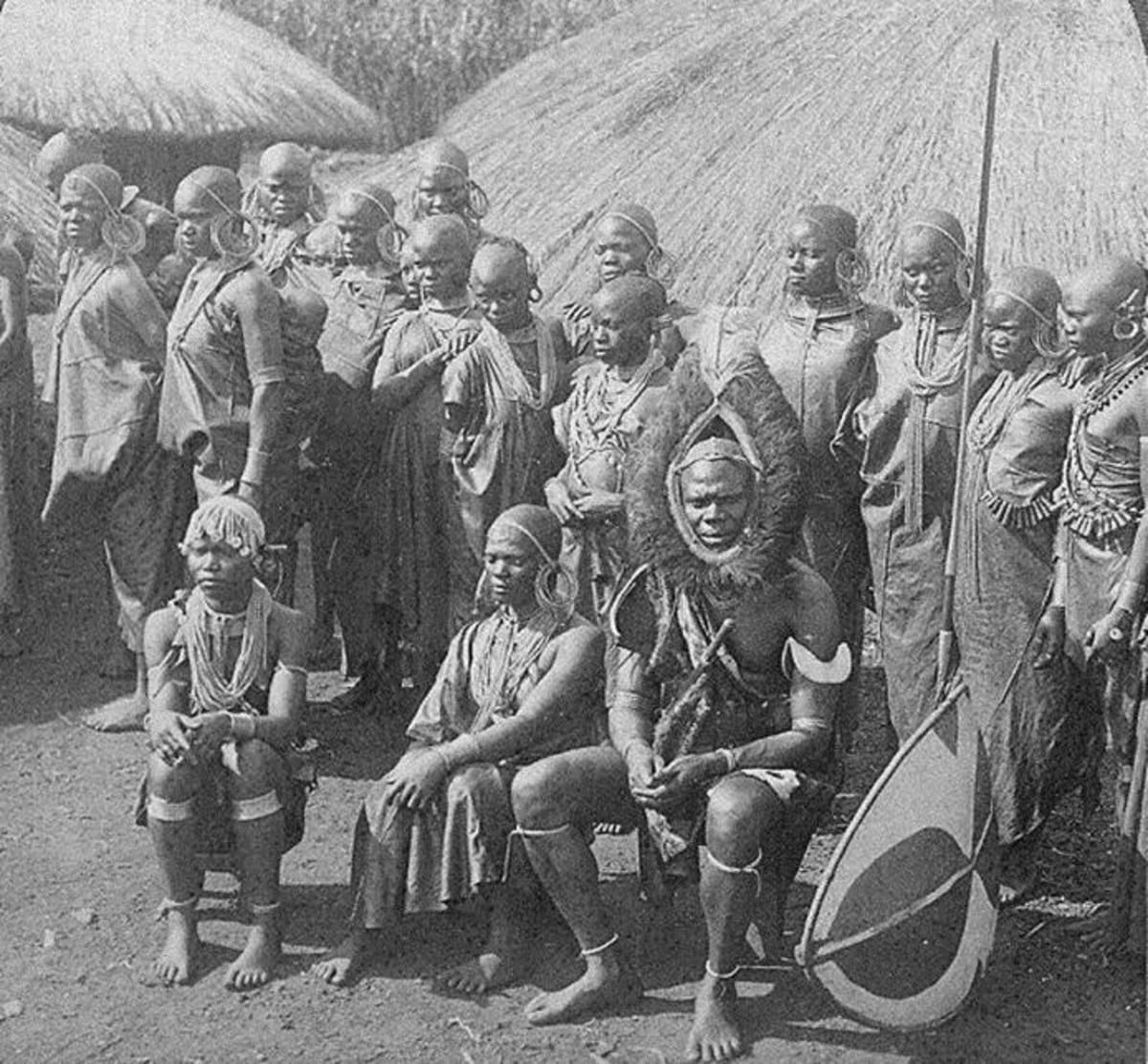 Chief Wambugu wa Mathangani in 1902 with his sixteen wives. Notice the headgear made of ostrich feathers.... And the girls are beautiful, especially the third one from right. Image Credit: Godfrey Muriuki and Neal Sobania