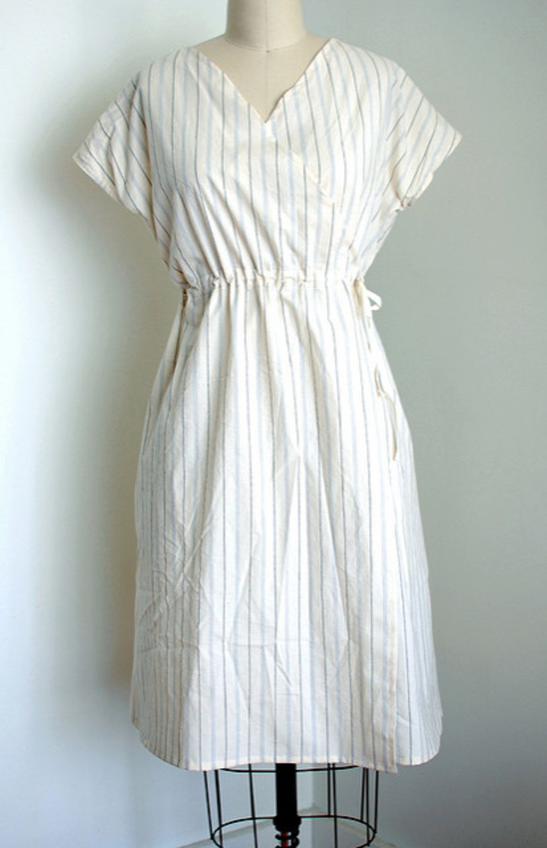If you're brave and good with a sewing machine, try making your own vintage reproduction dresses using vintage patterns and fabrics like this one.