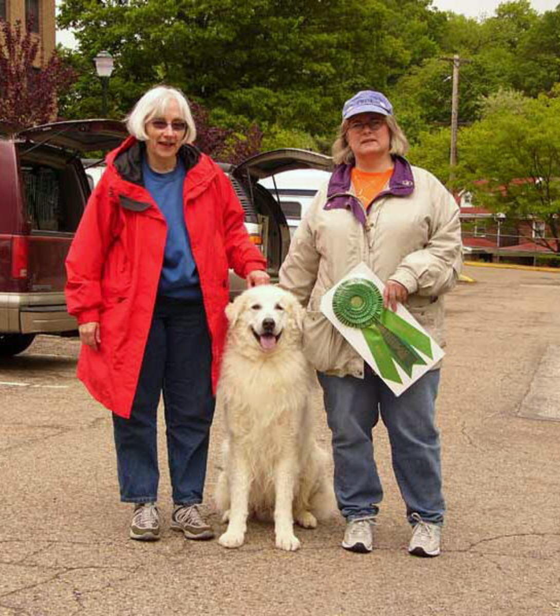 Dahmer with her Beamer with a TDX title. This picture was given by late Olga Schmidt of Brantwood Kuvasz.