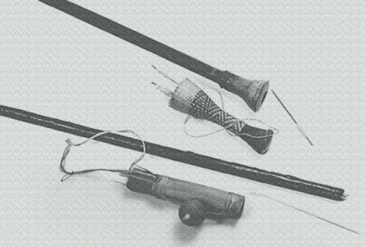 Jivaro Indian 8 ft. two-piece blowgun, darts and quiver. Gourd attach on side of quiver contains kapok which is wrapped around the rear area of the dart as an air seal. Cup also contain the curare poison.