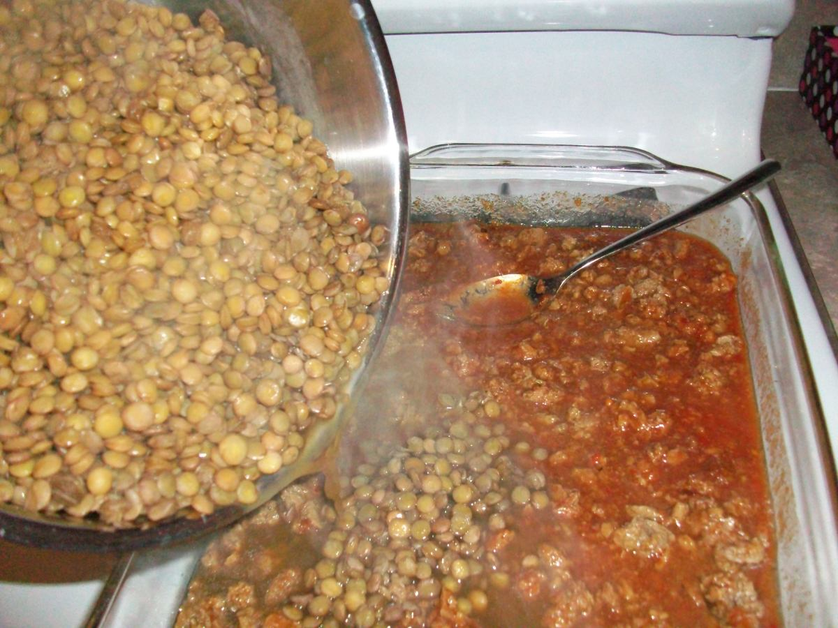 Add the hot lentils to the baking dish full of other ingredients, stir, and bake.