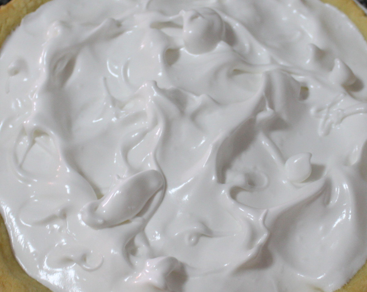 Top with meringue; meet the crust all the way around and your meringue won't sink away from the pasty
