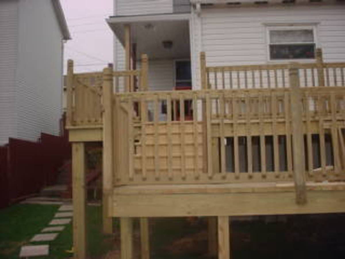 How to build a two level above ground pool deck attached for Above ground pool decks attached to house