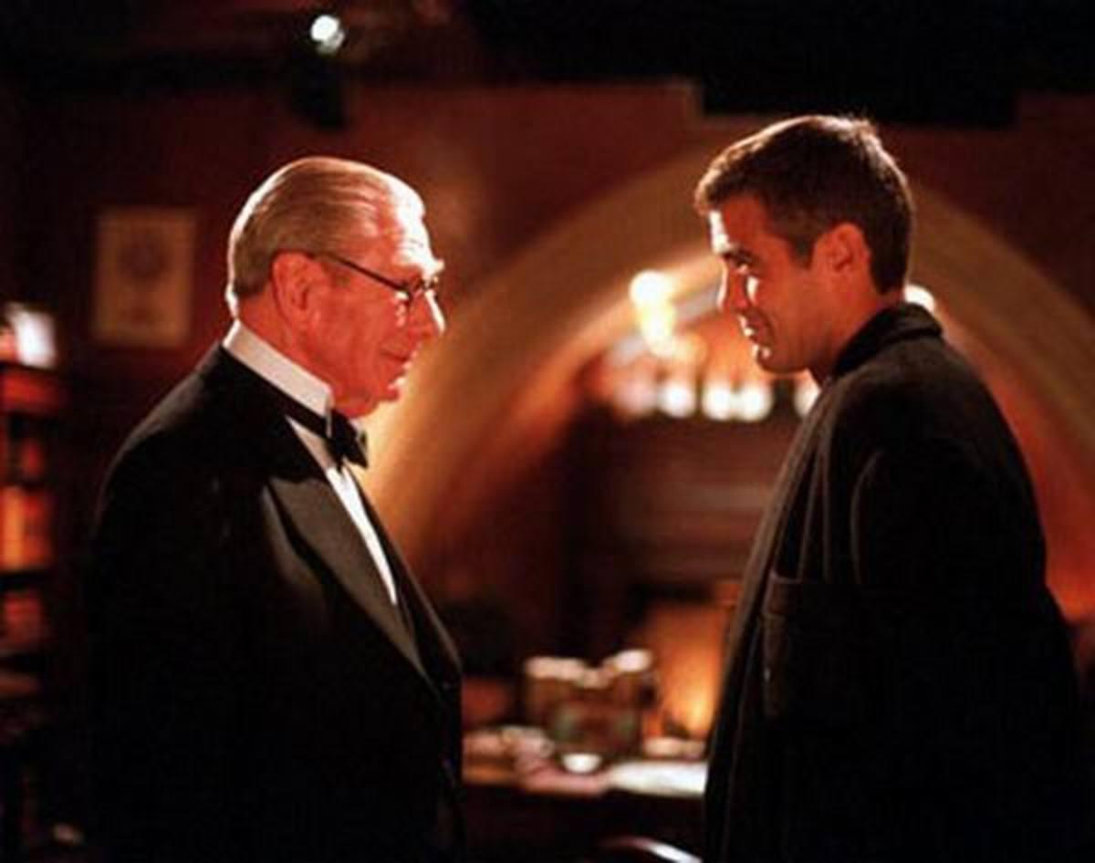 Michael Gough and George Clooney in Batman & Robin (1997)