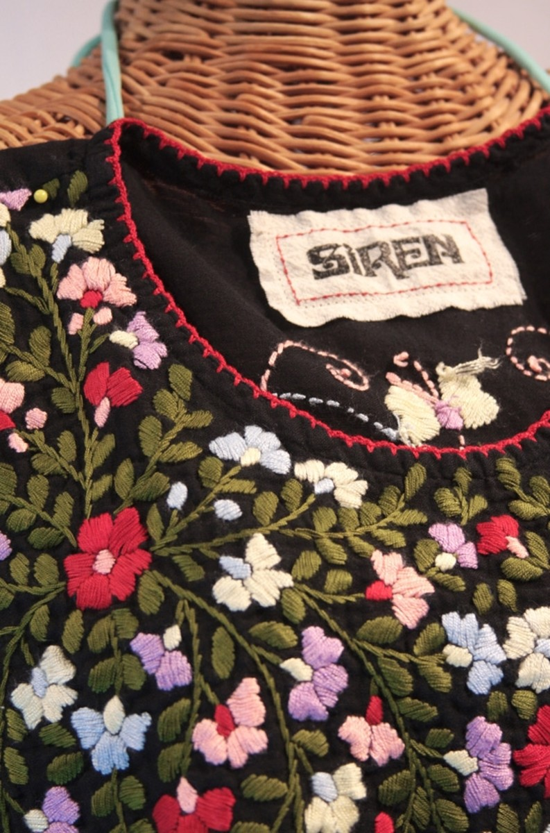 Lots of colorful floral embroidery is the hallmark of 1970s style Mexican peasant blouse finery.
