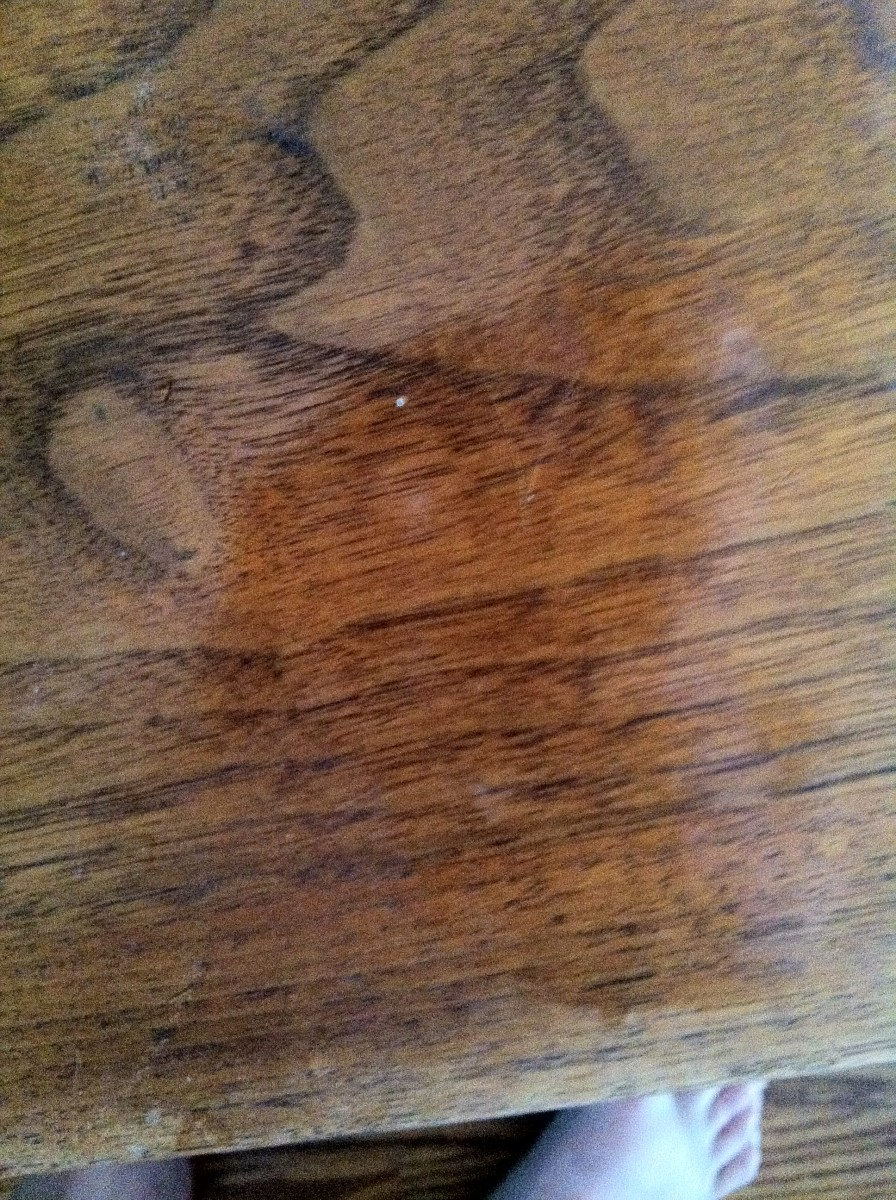 The second scratch is better--a second treatment and buffing may be needed yet to even out the look. I think this is because someone used wax furniture polish on the table at some point; it has an oil finish and wax should not have been used.