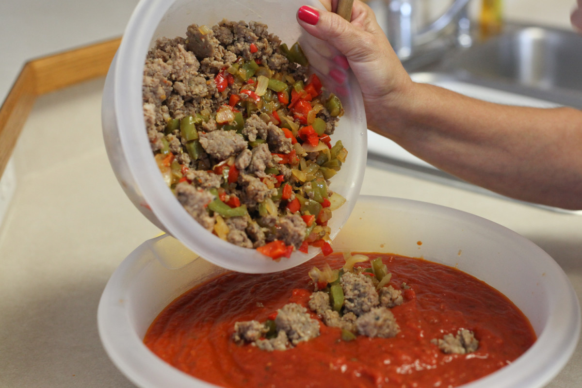 Mix peppers, onion, sausage and seasonings together with sauce.