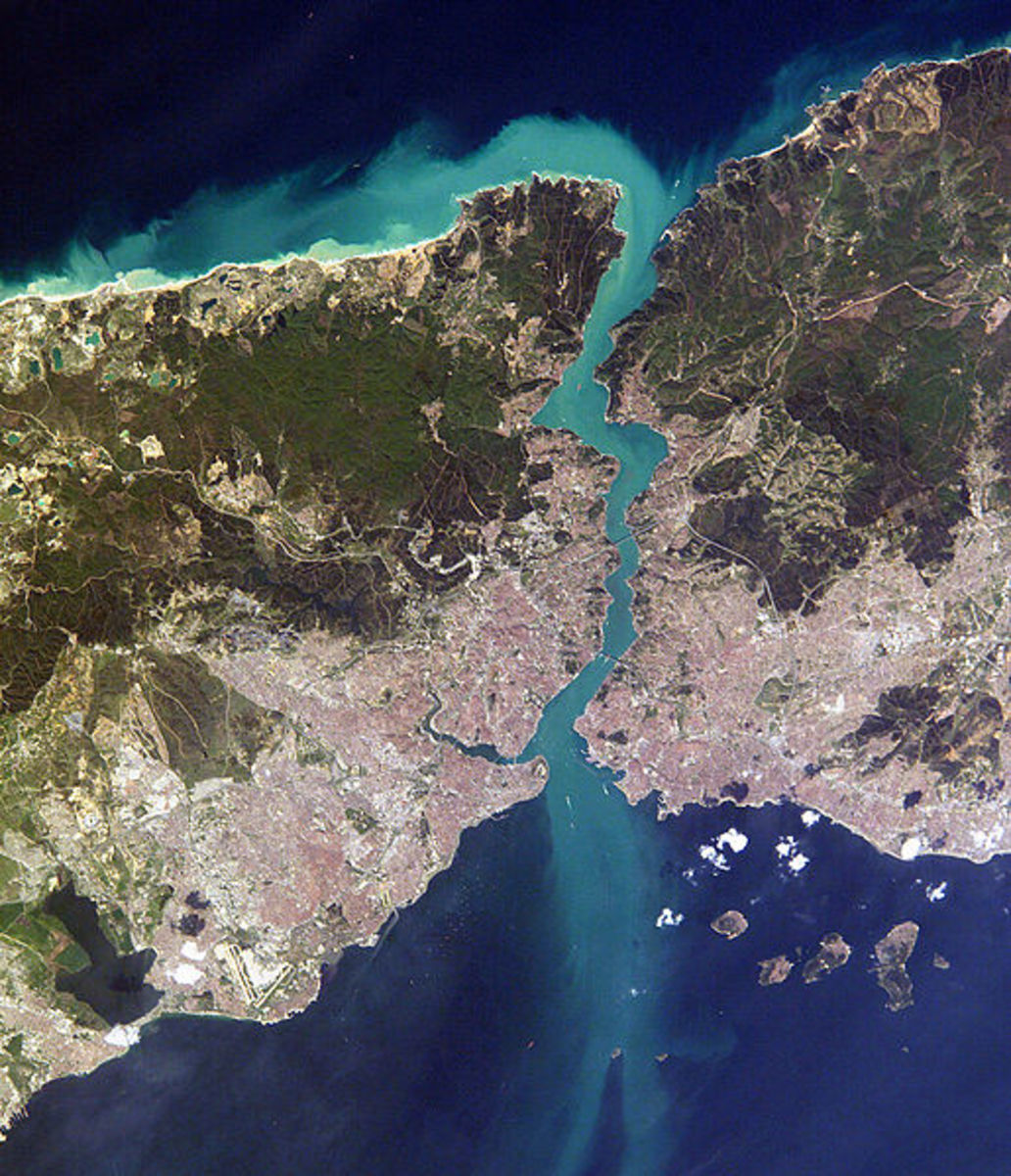 Arial shot of Istanbul, Turkey with the Bosphorus waterway running through the city.  The left is Europe and the right is Asia.