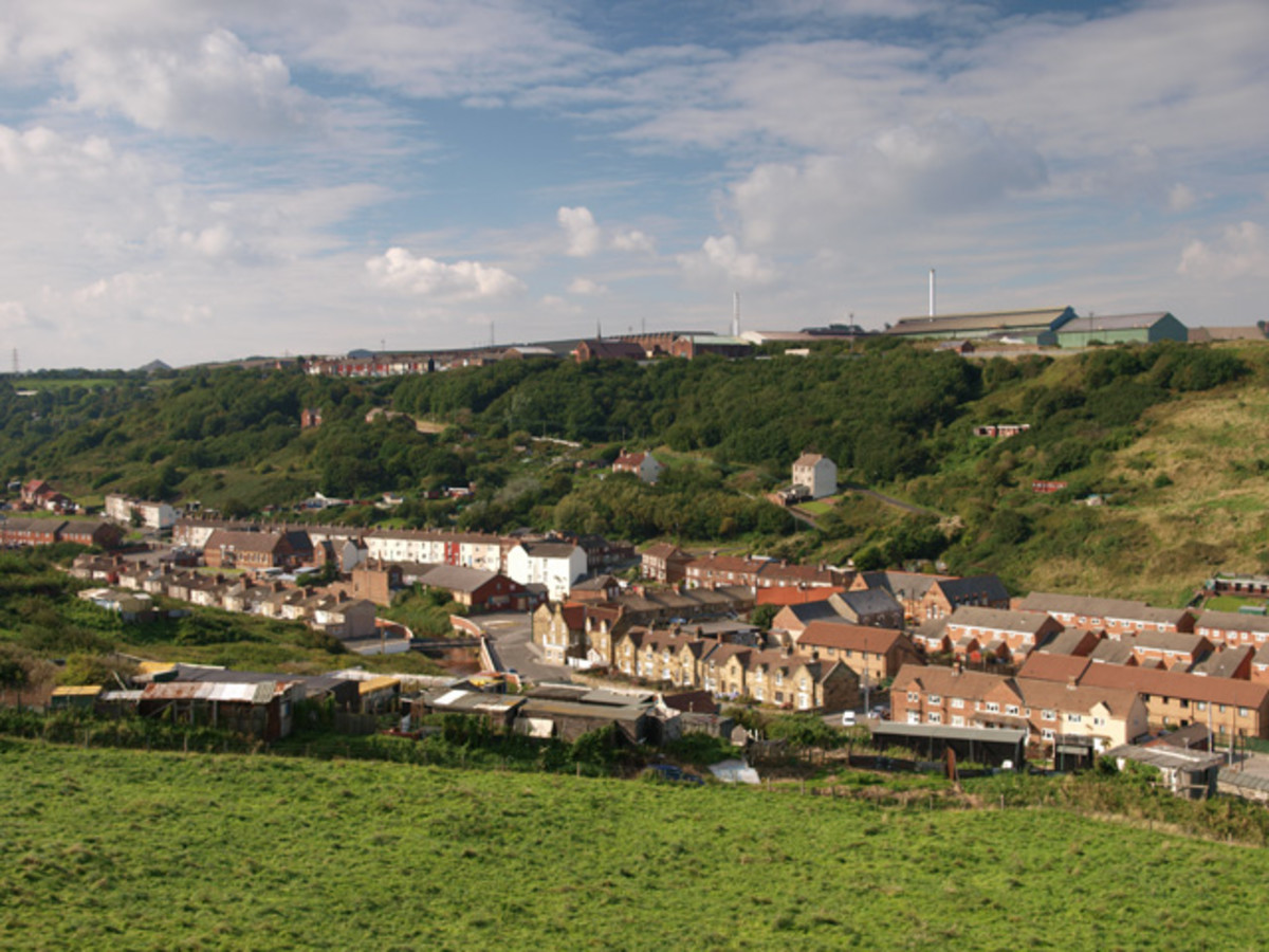Skinningrove village seen from the old jetty trackbed, with the much rationalised, almost phased out steel works on the plateau behind