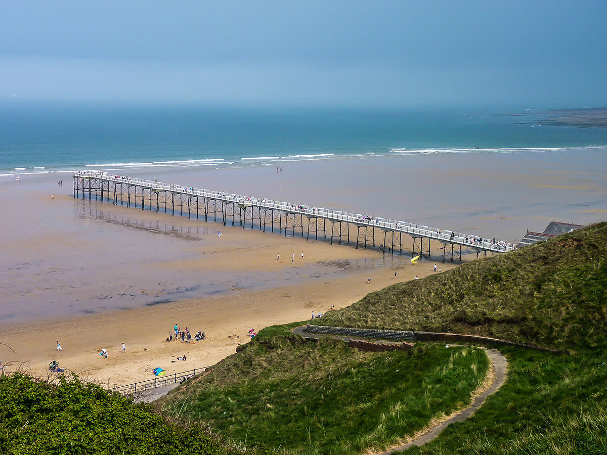 Seen from the north (Marske) side, Saltburn pier hardly reaches to the tide mark when it's at its lowest ebb