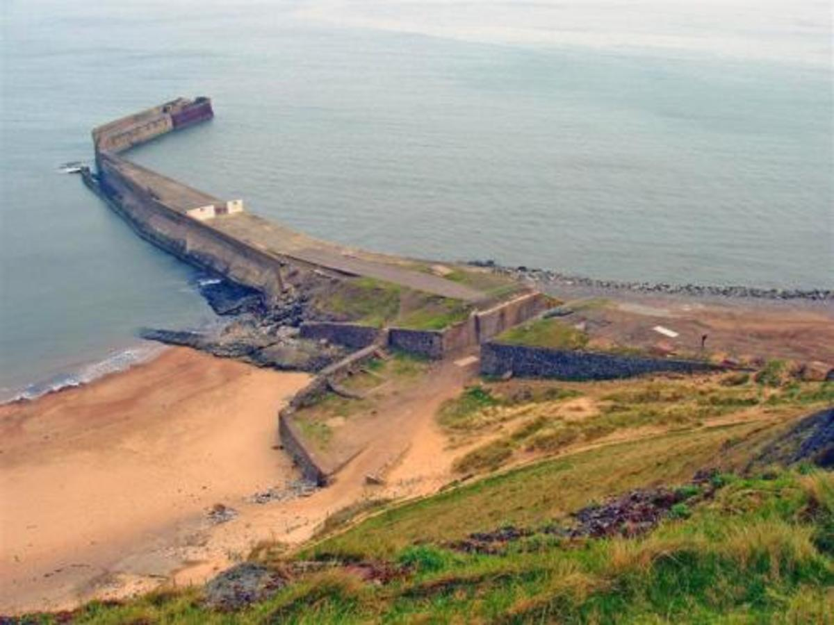 Skinningrove Jetty, once a loading point for locally mined ironstone, now a mecca for sea anglers - the name of the village stems from the Old Norse 'Shining Grove', a place of pagan worship