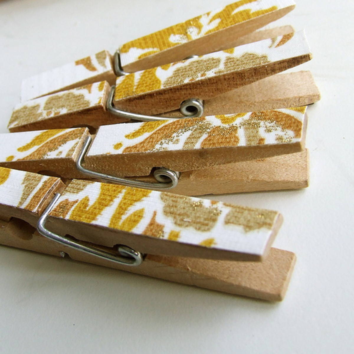 These clothespins are decorated with vintage wall paper.