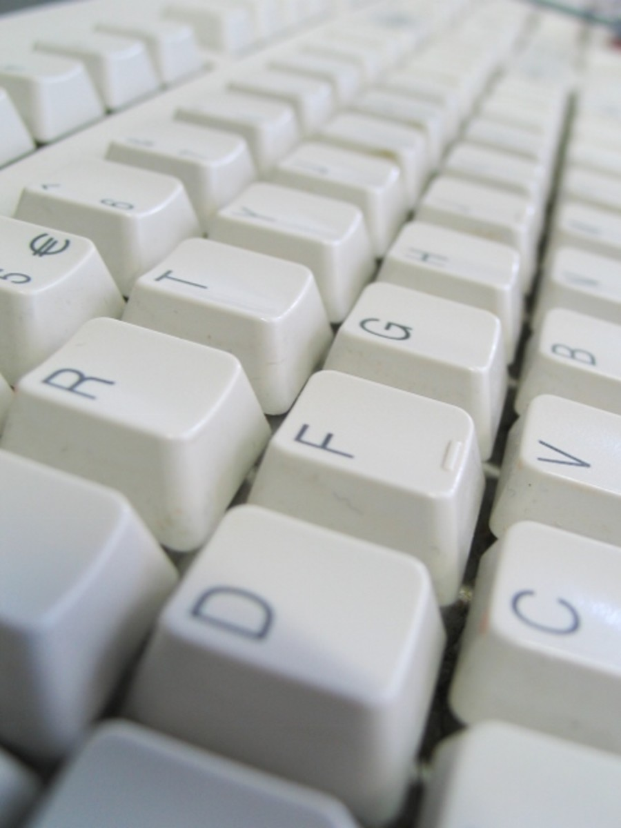 A writer's stark keyboard becomes void of inspiration due to writer's block.