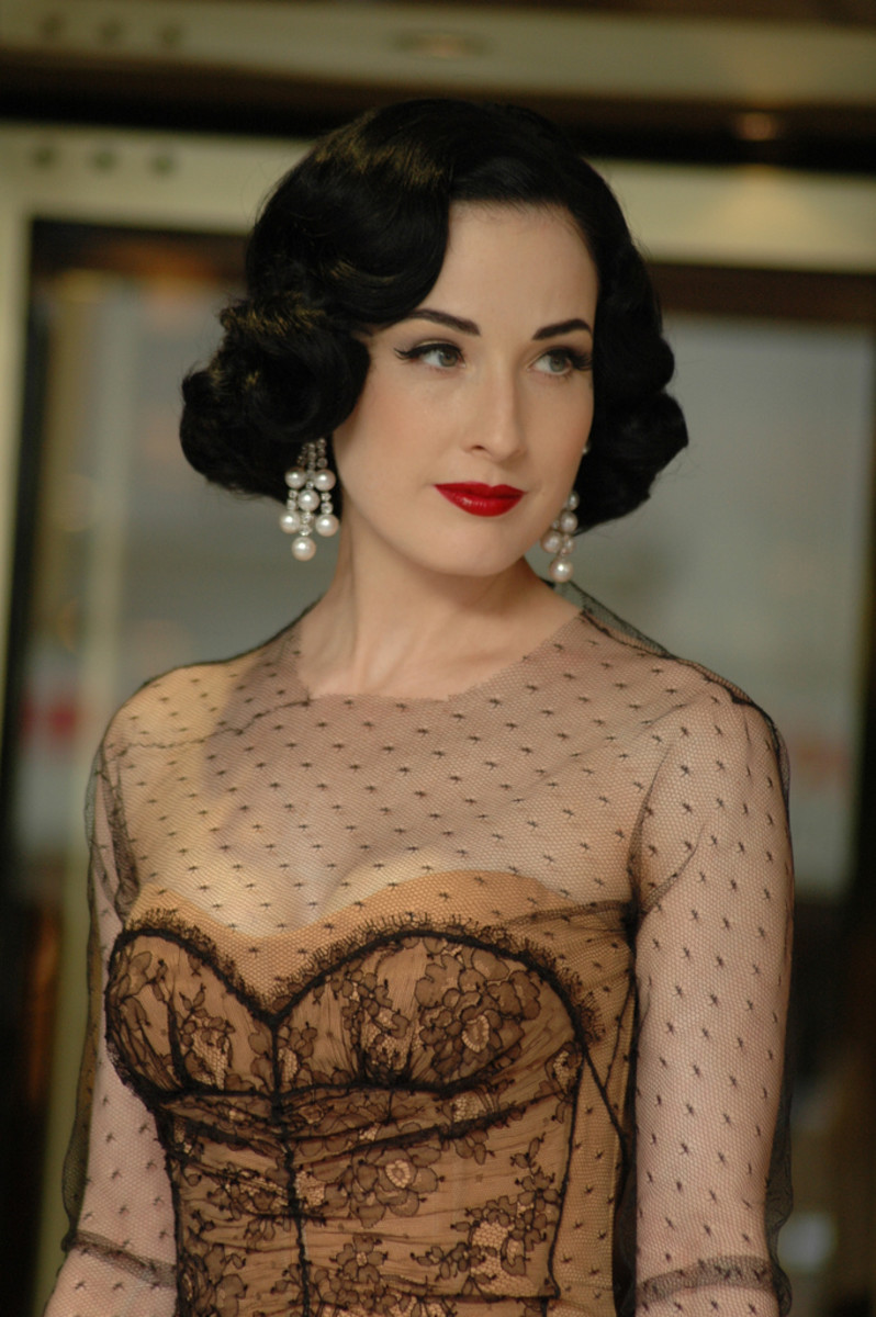 Dita Von Teese in 1920 styles hairdo and a Victorian style costume