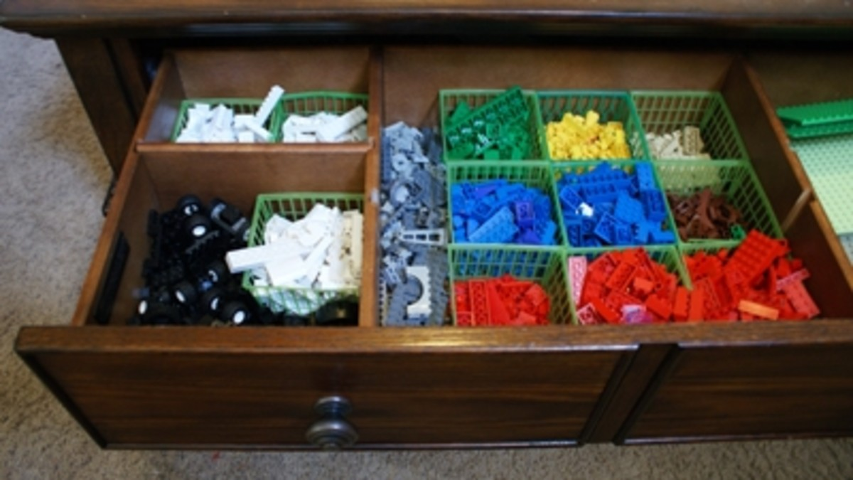 Our current Lego storage system is sorted by color into old strawberry baskets.