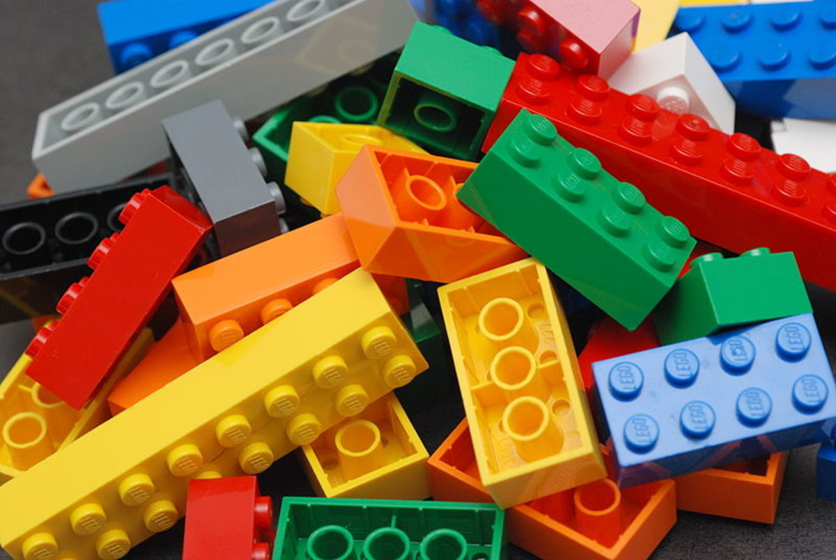 A pile of Lego blocks, of assorted colors and sizes.